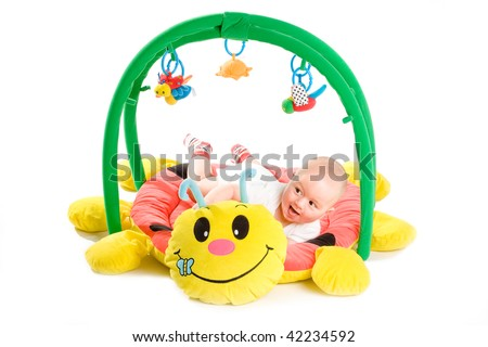 Happy baby playing in baby gym toy, isolated on white background.