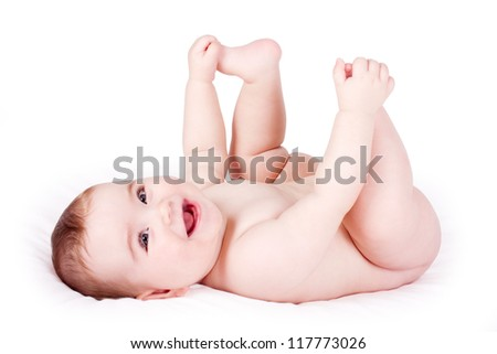 happy baby playing with his feet