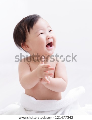 Happy baby smile and applaud and look empty copy space, asian child