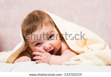 Happy baby under blanket