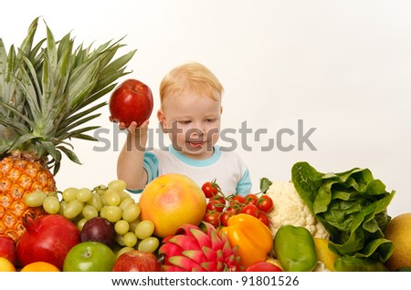 happy baby with fruits and vegetables - stock photo