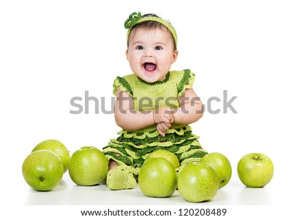 happy baby with green apples isolated on white background