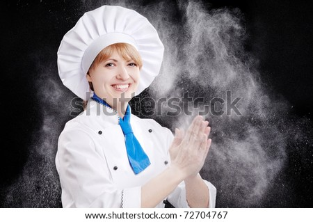 Happy baker woman on black background - stock photo