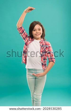 happy ballerina demonstrate hand position. young talented dancer. imagine she is prima. study in ballet school. child love dancing. small girl practice in dance studio. activities for kids Stockfoto ©