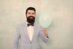 Happy bearded man hold air balloon. just inspired. happiness and success. Party mood. Happy birthday. Happy man with beard in jacket and bow. Formal party. Happy holiday. Formal man fashion.