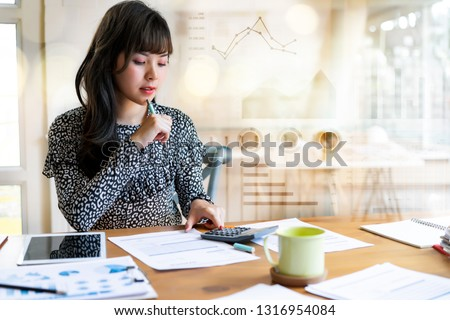 Happy beautiful asian woman working about financial with business report and calculator.financial or accounting concept.