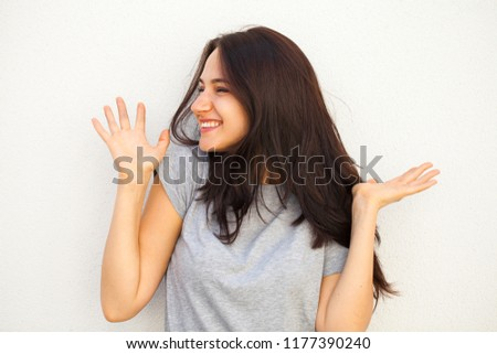 Happy Beautiful brunette woman in gray t-shirt, isolated on white wall background #1177390240
