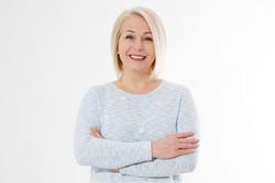 Happy beautiful close up portrait middle age blonde woman. Mid aged healthy female isolated on white background with copy space. Menopause and healthcare. Mature lady wrinkled face. Folded hands