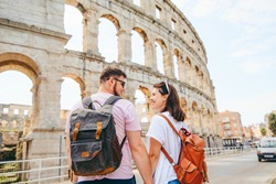 happy beautiful couple in front of coliseum in Pula Croatia. travel concept