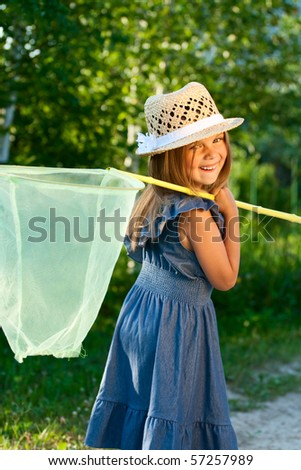 Happy beautiful girl with butterfly net at the sunshine.