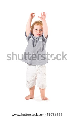 Happy beautiful little kid raising arms to celebrate isolated on white background