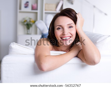 Happy beautiful smiling woman having resting at home - indoors