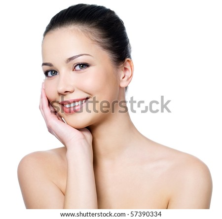 Happy beautiful woman's face with fresh clean skin - isolated on white background