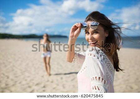 happy beautiful woman standing...