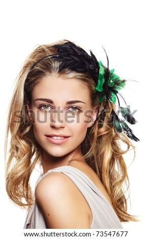 happy beautiful woman with long blond hair in big hairstyle, wearing flower headband with green and black feathers on white background