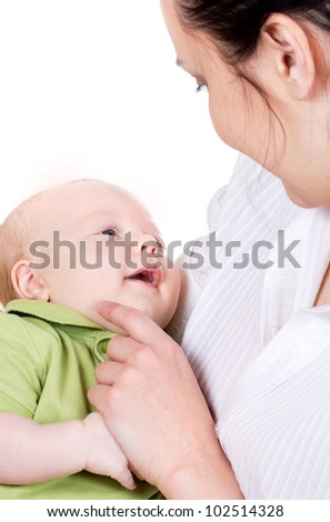 happy beautiful young mother holding her smiling little baby