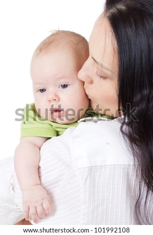 happy beautiful young mother kissing her smiling little baby isolated on white background in studio