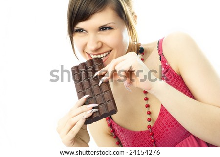 happy beautiful young woman eating a bar of chocolate