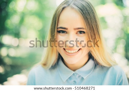 happy beautiful young woman laughing and smiling on nature in green #510468271