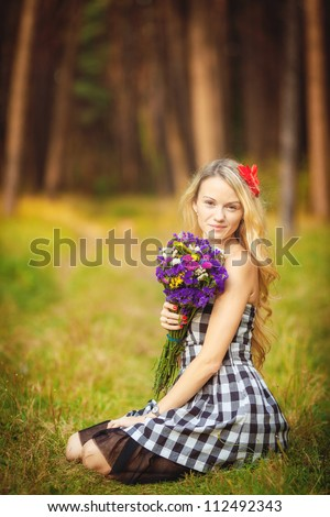 Happy beautiful young woman outdoors in autumn park