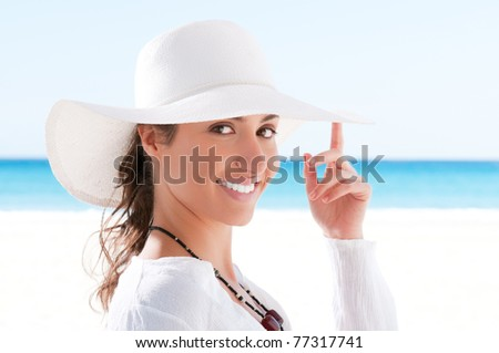 Happy beautiful young woman smiling and looking at camera at summer beach