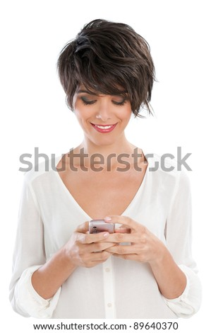 Happy beautiful young woman text messaging and surfing the net with her smart phone isolated on white background