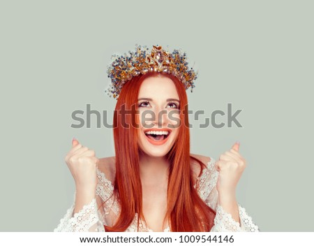 Happy beauty queen woman exults pumping fists ecstatic celebrates success pretty woman winner looking up happy with crystal crown on head isolated on light gray background wall #1009544146