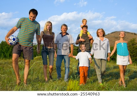 Happy big family have a rest in park - stock photo
