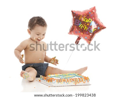 Happy Birthday!  Adorable boy eating a birthday cake.  Isolated on white with room for your text.