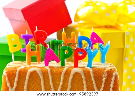 happy birthday. birthday cake with letter candles and gifts. card concept