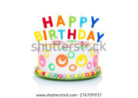 happy birthday cake or tart with happy birthday letters as candles very colourful and looking very tasty, isolated on white background