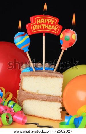 happy birthday cake candles. stock photo : Happy birthday cake with burning candles.