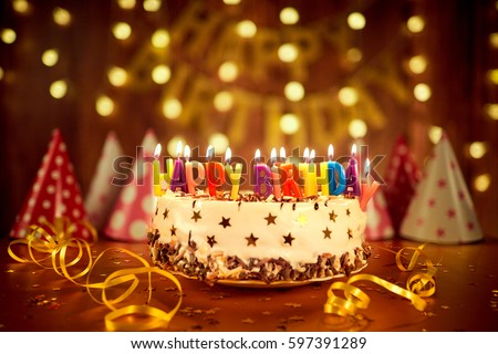 Happy birthday cake with candles on the background of garlands a #597391289