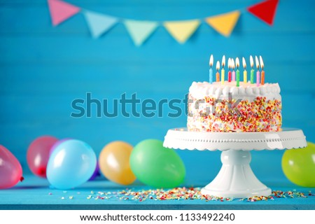 Happy birthday cake with colorful balloons decoration. Birthday card. #1133492240