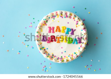 Happy birthday cake with rainbow lettering