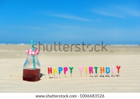 Happy Birthday Candles And Bottle Lemonade At The Beach 1006683526