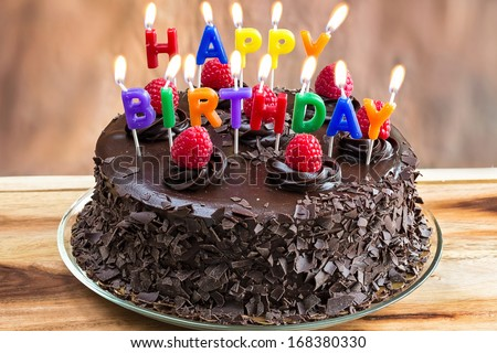 Happy Birthday Candles On Chocolate Cake Stock Photo