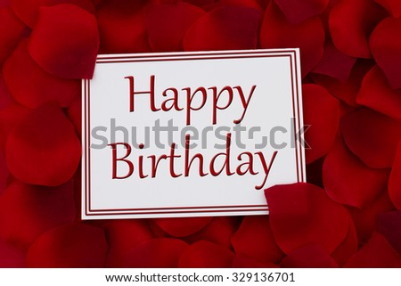 Happy Birthday Card, A white card with text Happy Birthday and a red rose petal backgrounds