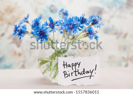 Happy birthday card with bouquet of blue cornflower flowers