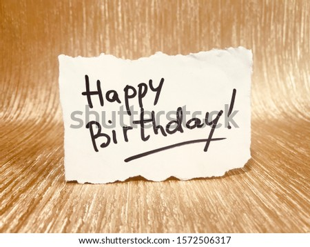 Happy birthday card with lettering on glitter gold background
