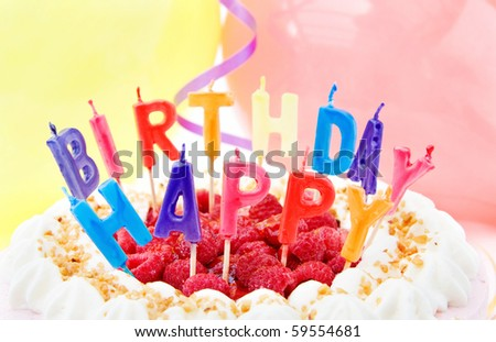 Happy Birthday - celebration with festive raspberry cake and balloons.