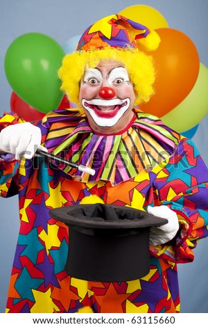 Happy birthday clown does a magic trick with a top hat and wand.