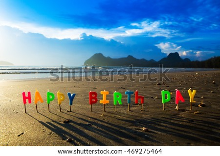 Happy Birthday Colorful Candles On A Beach 469275464
