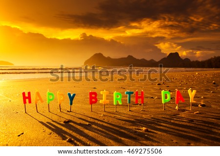 Happy Birthday Colorful Candles On A Beach Sunrise 469275506
