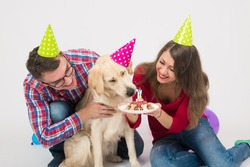 Happy birthday dog with friendly family over white