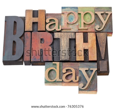 Happy Birthday in antique wood letterpress printing blocks, isolated on white