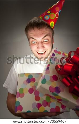 Happy birthday man opening big gift box