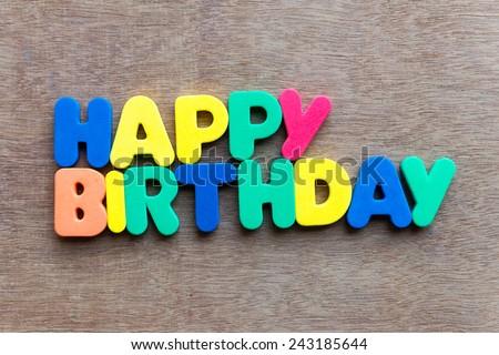 Happy birthday on wooden background