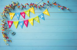 Happy birthday party background with text and colorful tools, top view