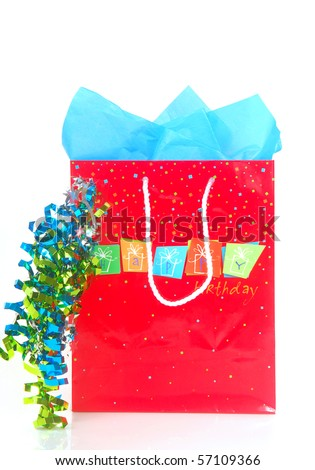 Happy Birthday shopping bag with brightly colored ribbons and tissue paper